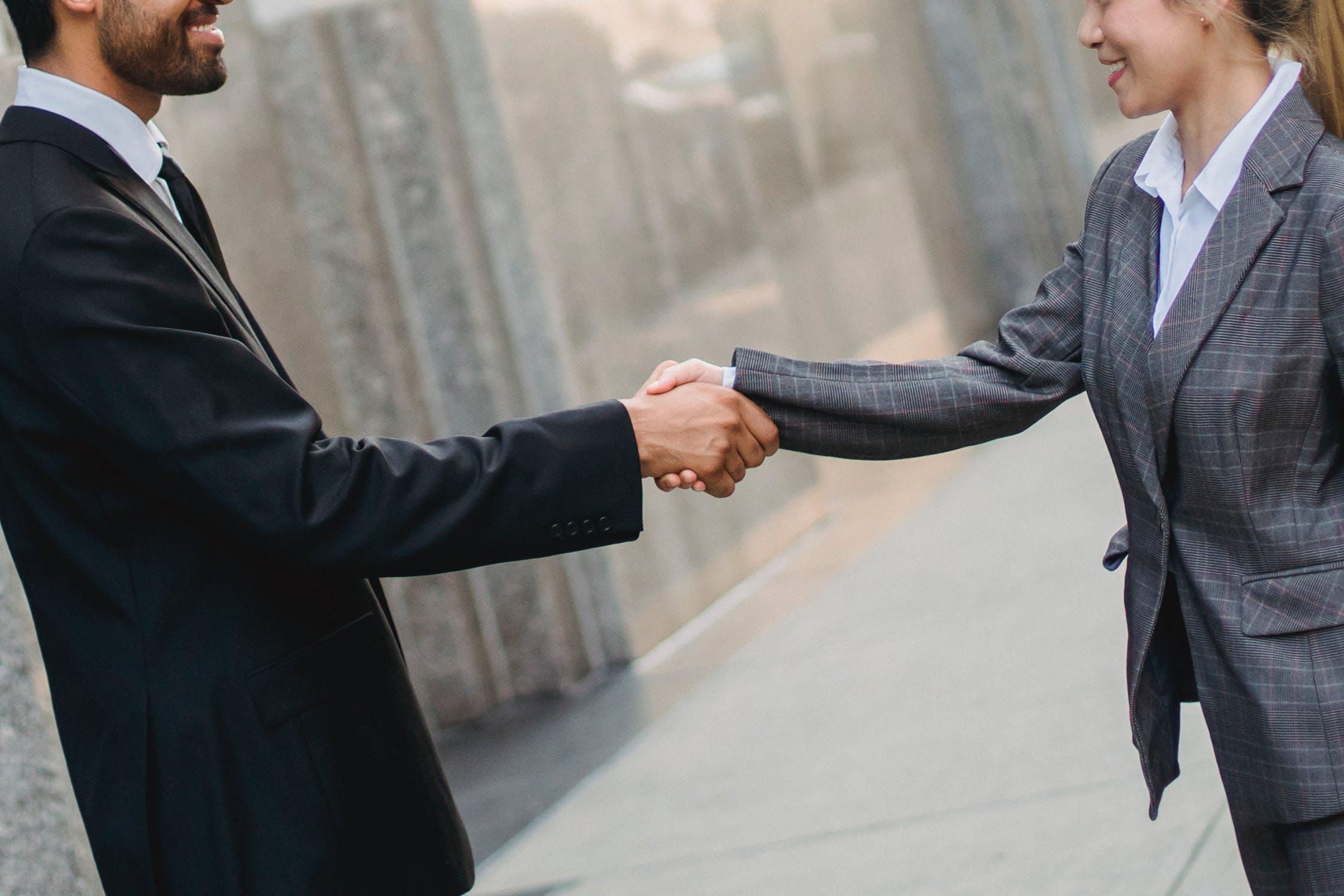 Two shareholders making a verbal agreement via a handshake.