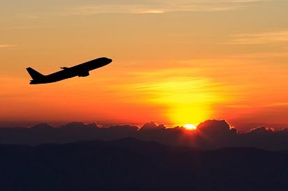 Plane Flying over Sunset