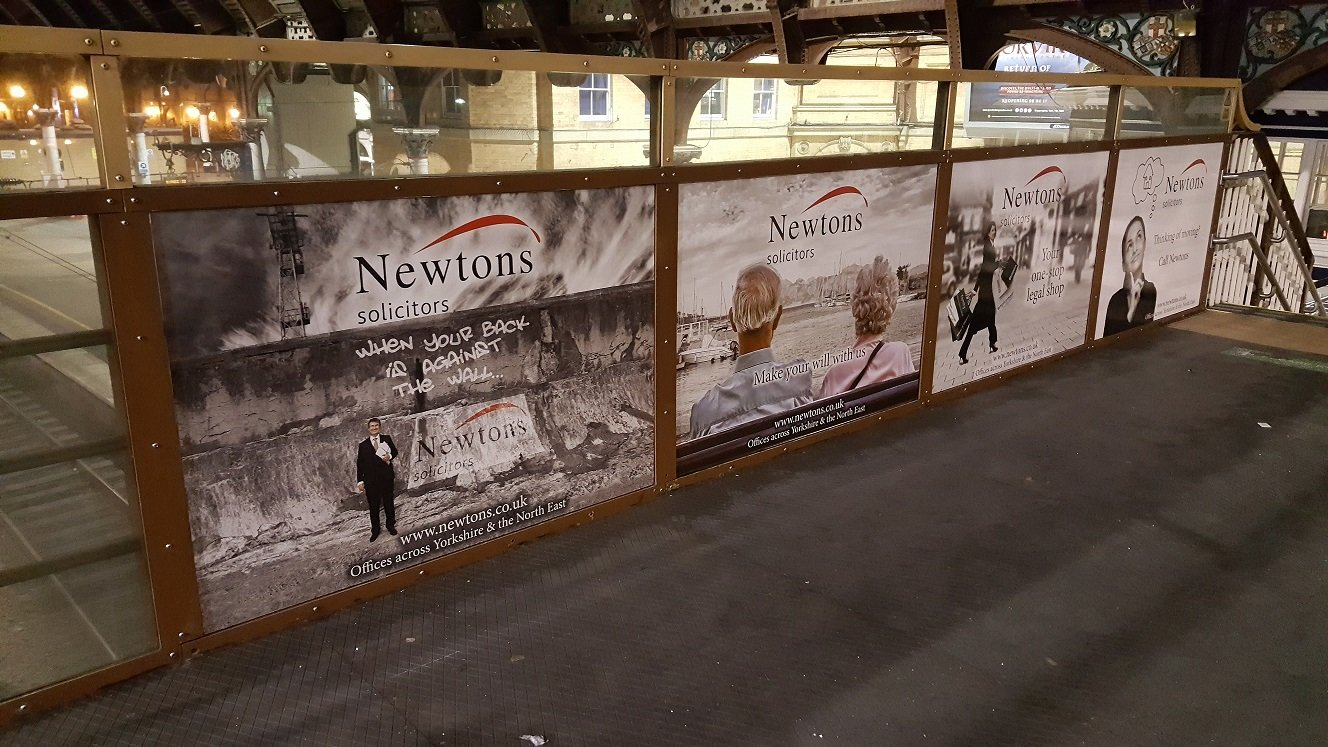 Newtons Solicitors Advertisement on a Railway Bridge at York Train Station